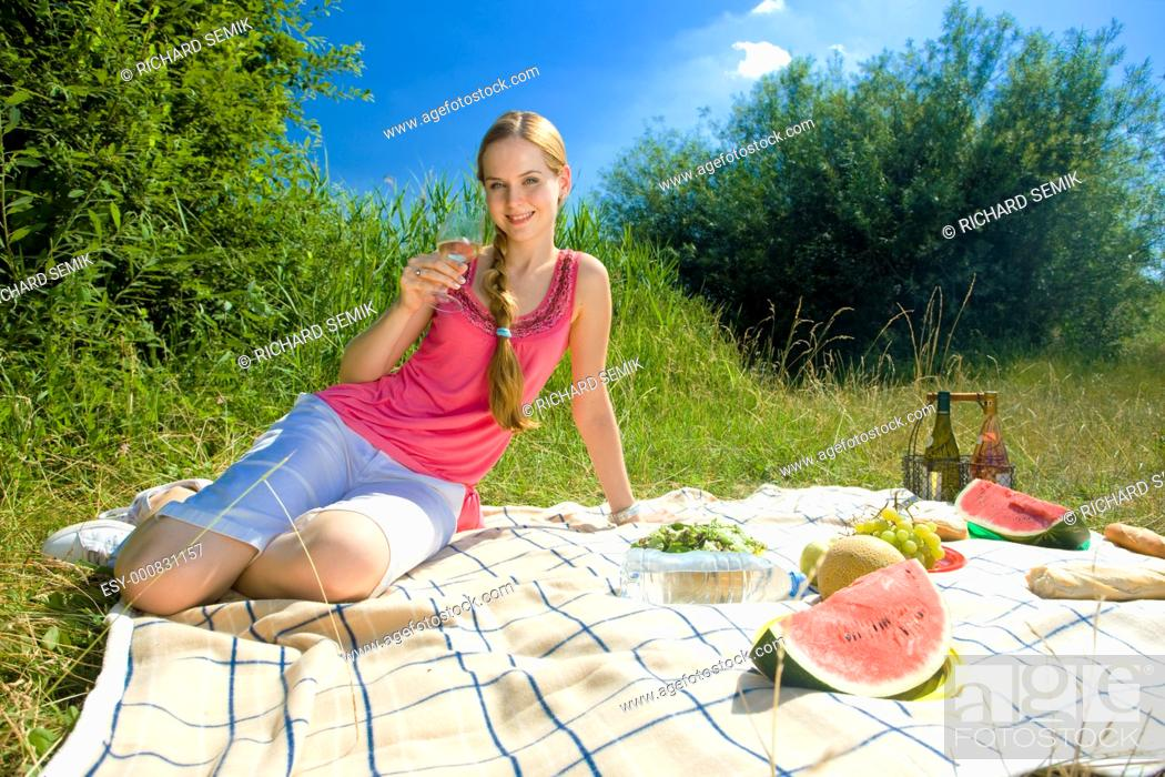 Stock Photo: woman at a picnic.