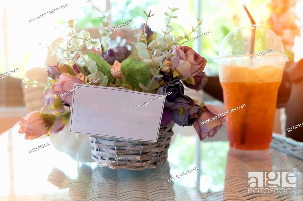 Stock Photo: white paper blank on flowers vase decorated in cafe.