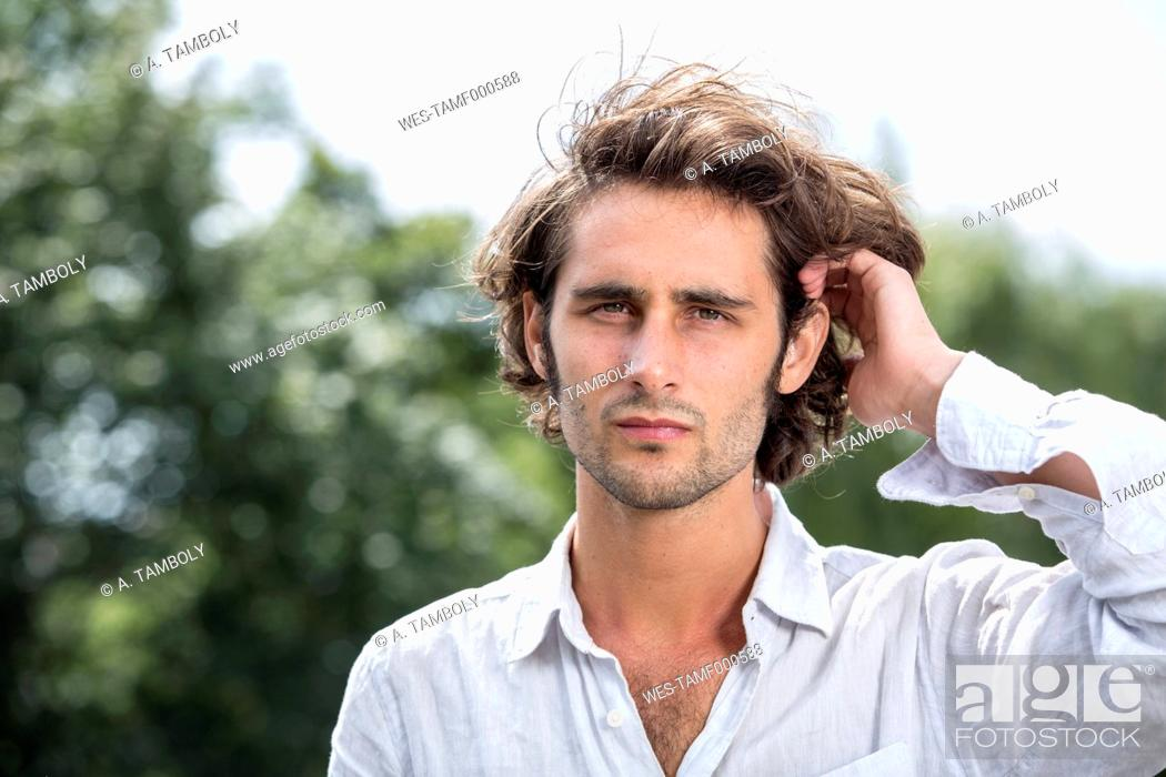Stock Photo: Portrait of young man with brown hair.