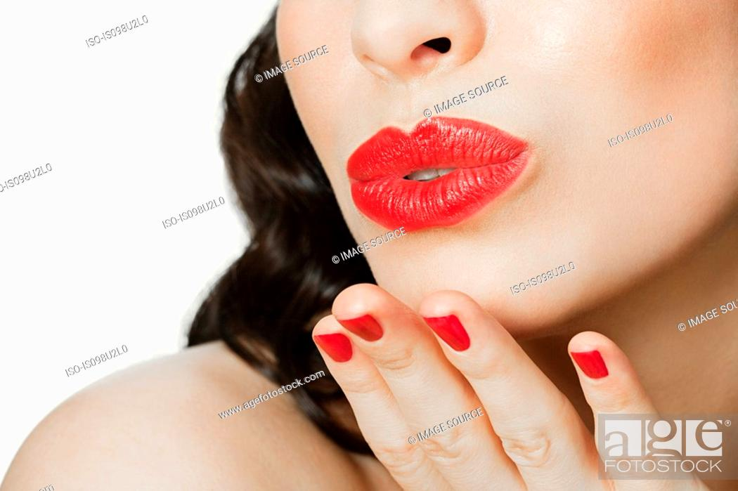 Stock Photo: Young woman blowing a kiss.