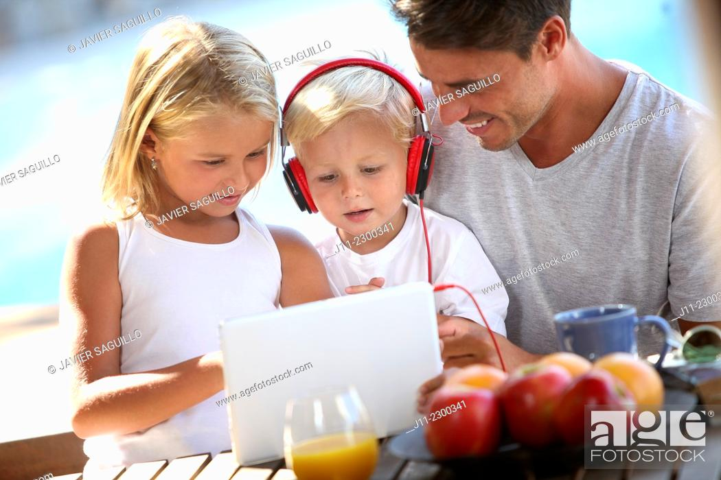 Stock Photo: Family, children with digital tablet and headphones.