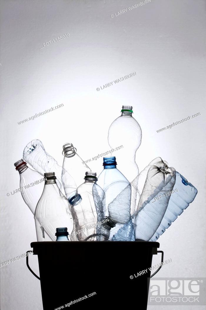 Stock Photo: Bottles in bucket.