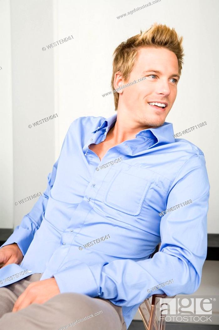 Stock Photo: Young man, smiling, portrait.