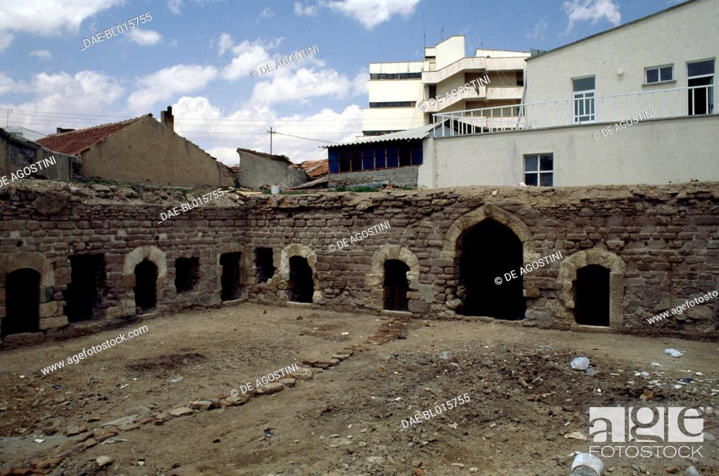 Old Abandoned Building Next To Modern Buildings Of Konya Central