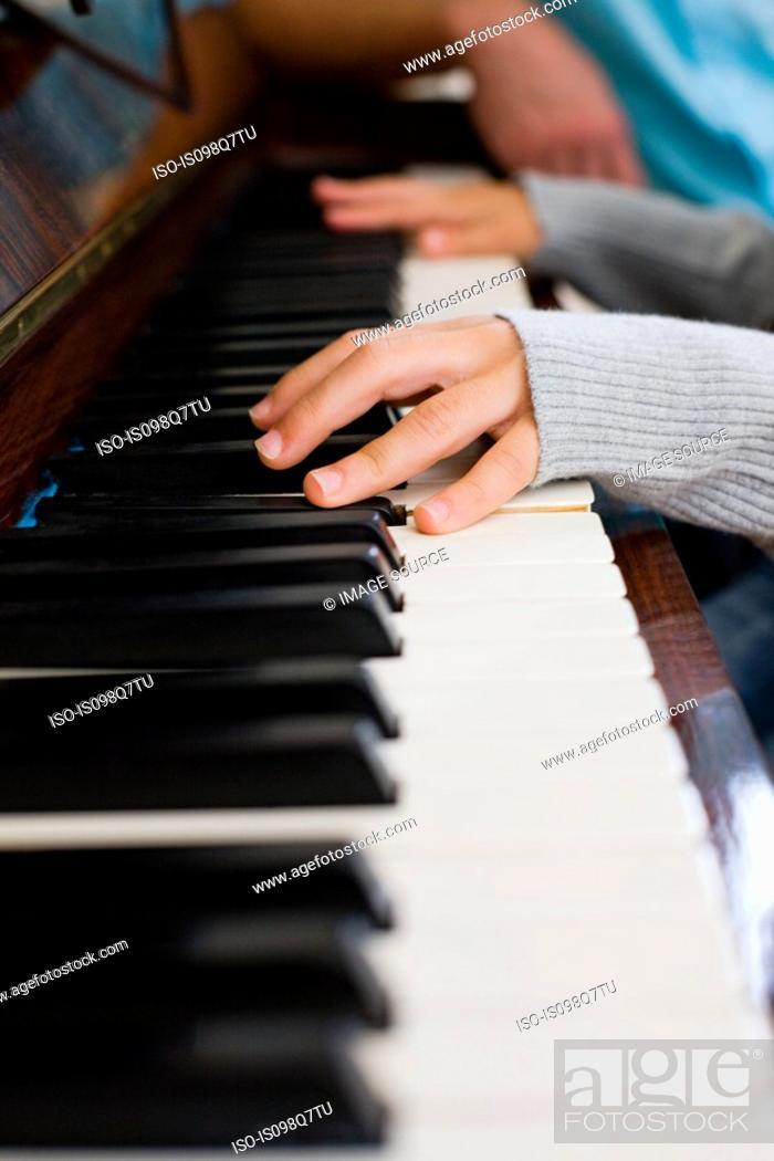 Stock Photo: Girl playing piano.