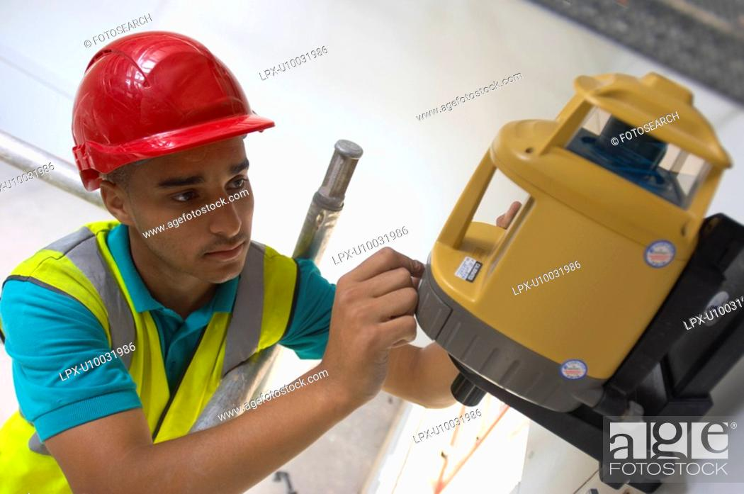 Stock Photo: Building technician installing a laser level.