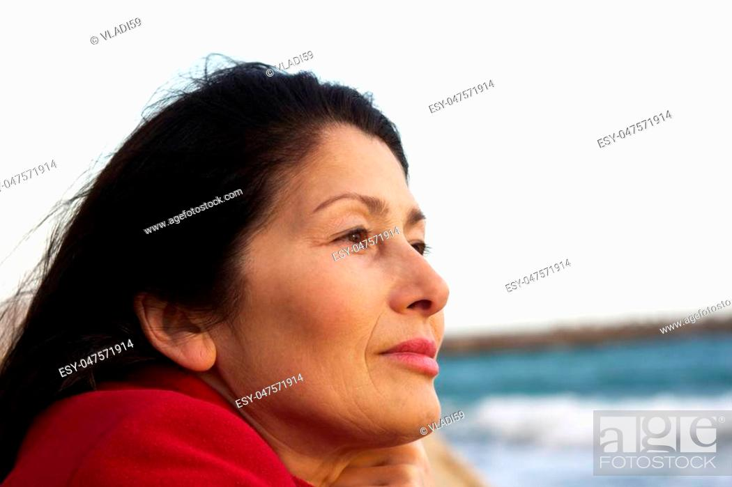 Stock Photo: Portrait of the woman enjoying an autumn sunlight.
