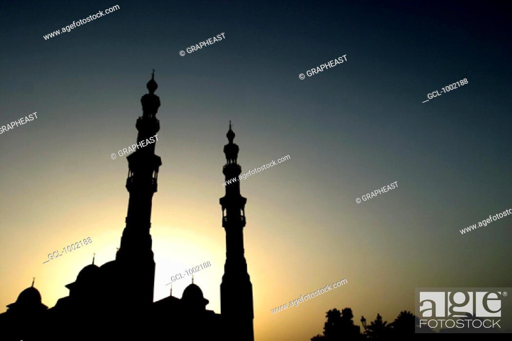 Stock Photo: Silhouette of a mosque at sunset, Dubai, United Arab Emirates.