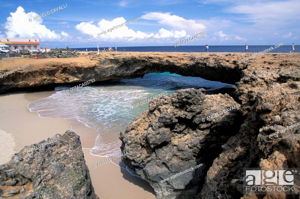 Stock Photo: Antilles, Aruba, 100 feet long rock natural bridge on the North coast.