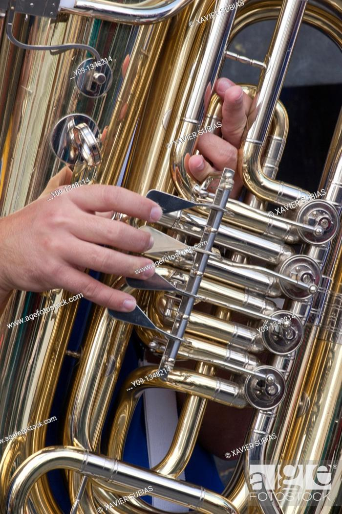 Stock Photo: Musician hands playing tuba.