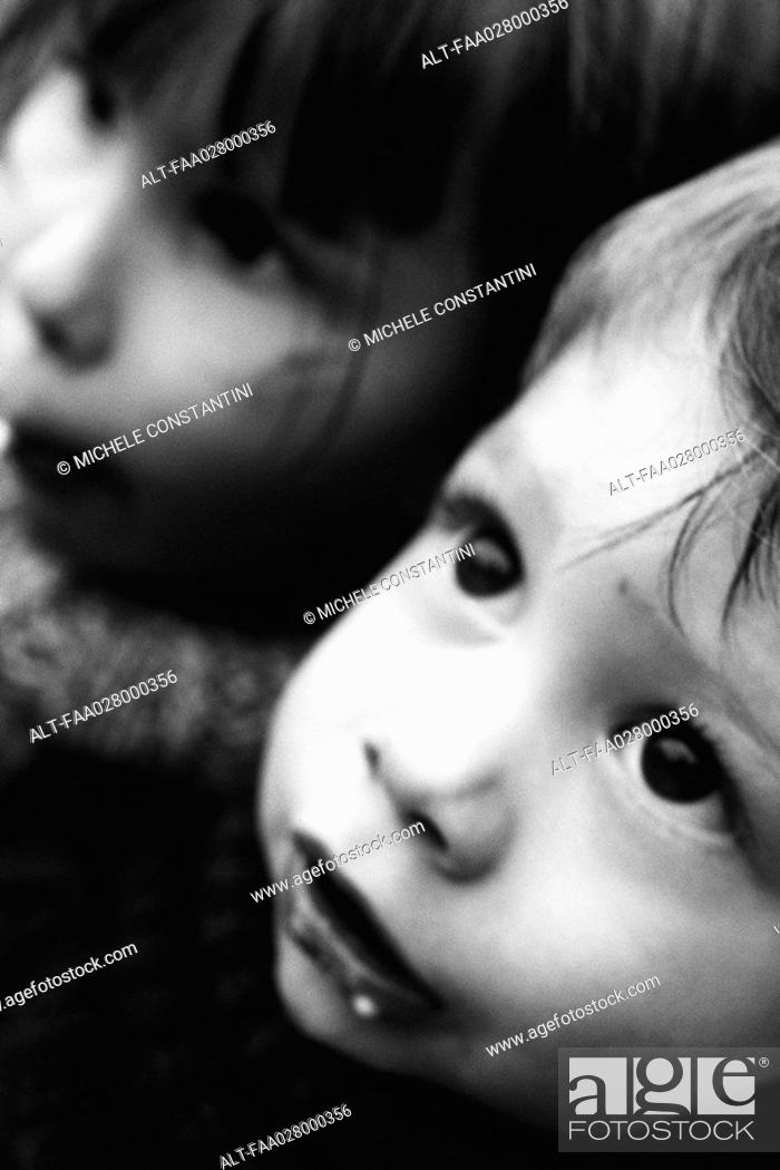 Stock Photo: Two children looking up, portrait, close-up, cropped.