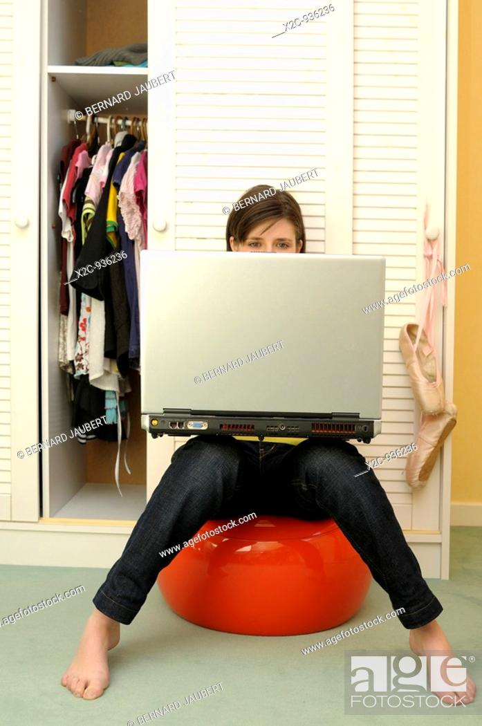Stock Photo: girl in bedroom whith computer.