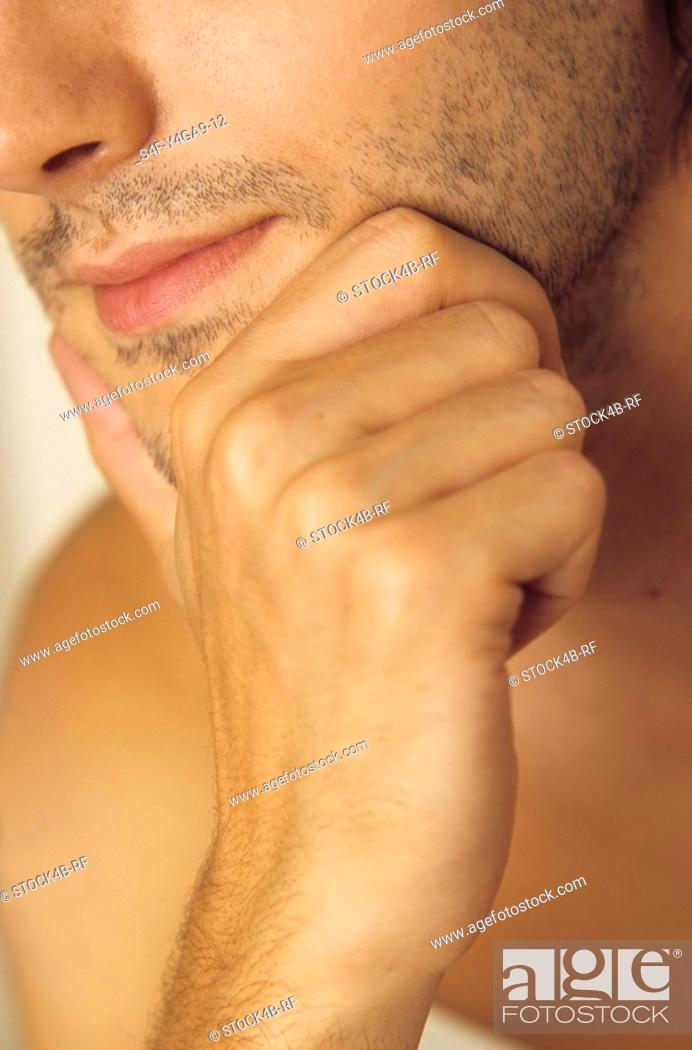 Stock Photo: Man resting his Chin with one Hand - Three-Day Beard - Masculinity.