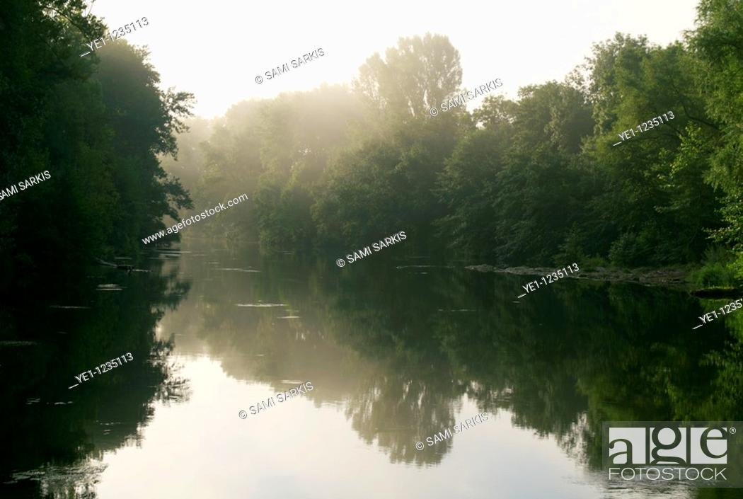 Stock Photo: Orb river in early morning haze, Herault, France.