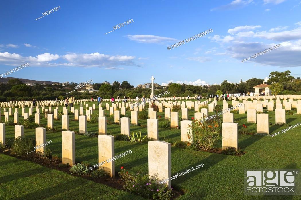 Stock Photo: Rows of headstones and memorial cross in Souda Bay War Cemetery at sunrise, Chania region, Crete Island, Greece.