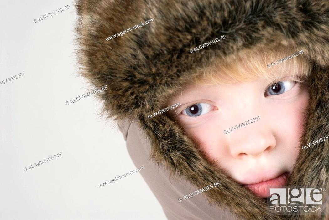 Stock Photo: Close-up of a girl thinking and looking sideways.