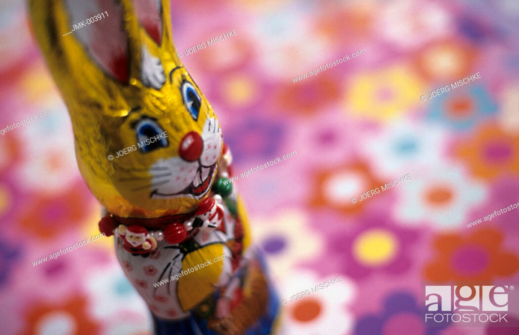 Stock Photo: A chocolate Easter bunny on a coloured ground.