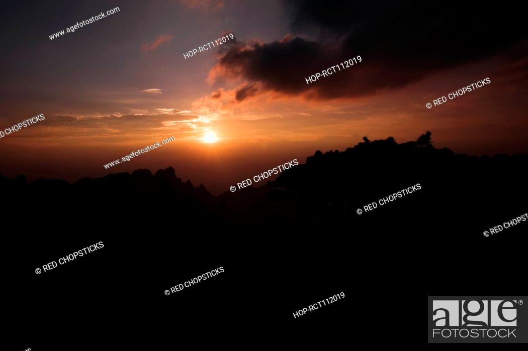 Stock Photo: Sunset over a mountain, Huangshan Mountains, Anhui Province, China.