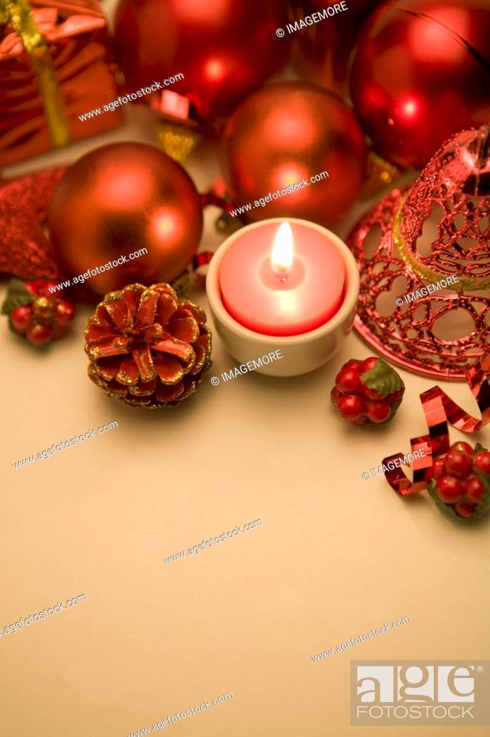 Stock Photo: Candle and Christmas ornament.