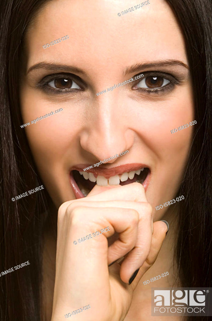 Stock Photo: Woman biting her finger.