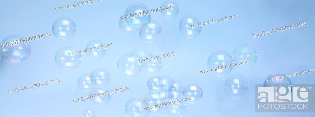 Stock Photo: Bubbles with blue background.