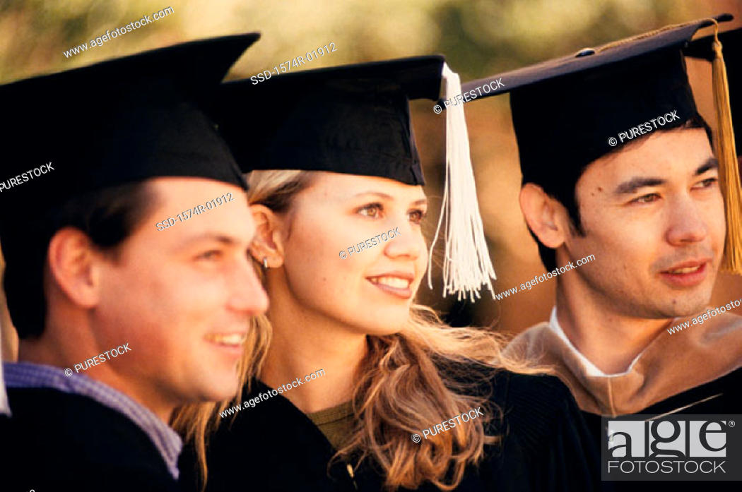 Stock Photo: Close-up of teenagers in graduation outfits.