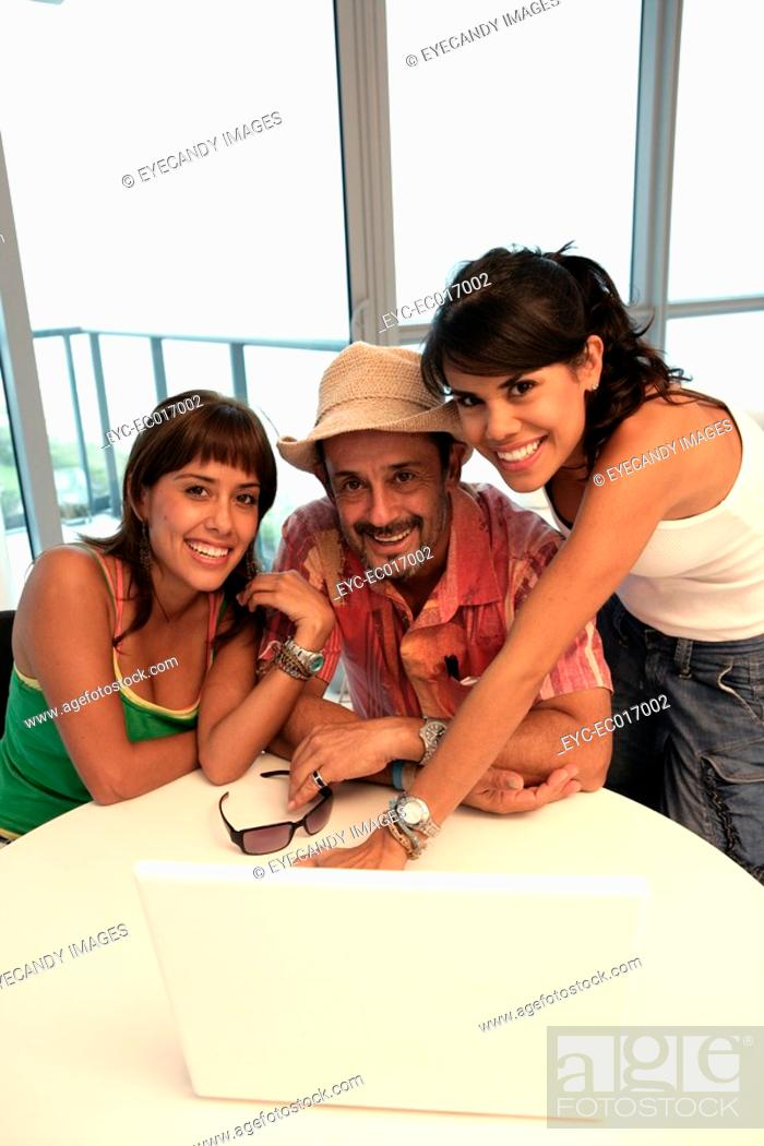 Stock Photo: Portrait of a man with two women.
