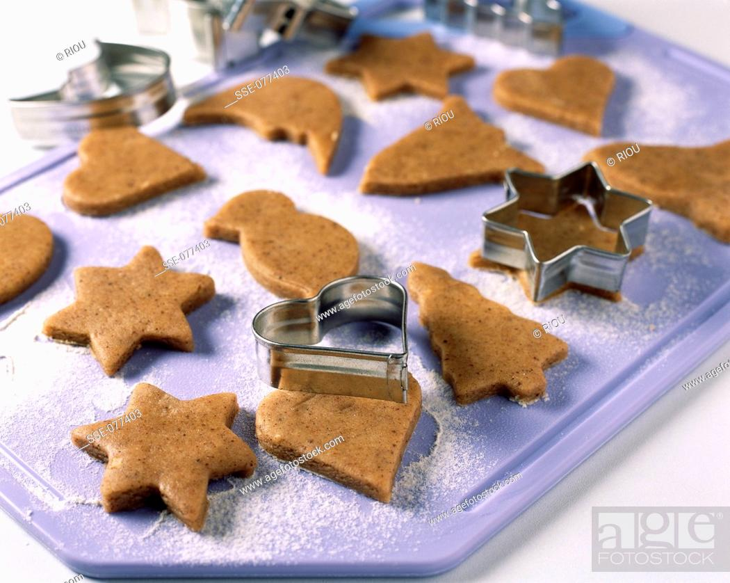 Stock Photo: cutting cookies with cookie cutter.