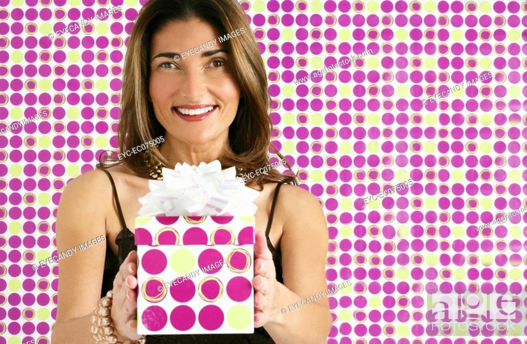Stock Photo: Woman holding gift box.