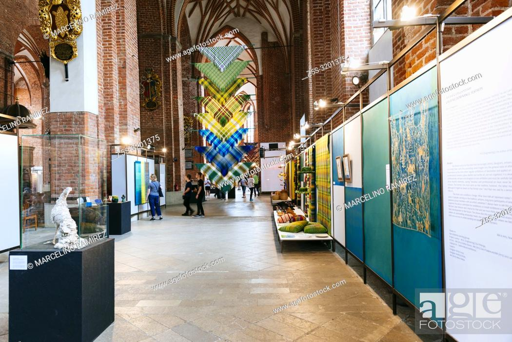 """Stock Photo: Exhibition of Arts and crafts """"""""""""""""Creative Dominance"""""""""""""""". National cultural identity. St. Peter's Church is a Lutheran church in Riga, the capital of Latvia."""