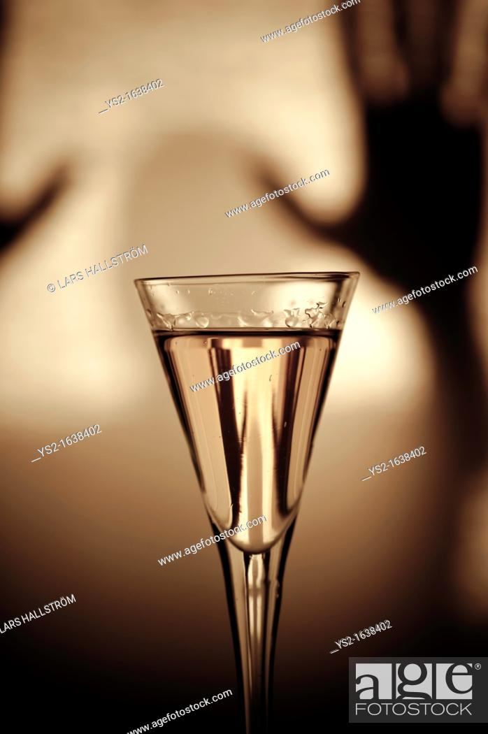 Stock Photo: Silhouette and glass of Schnaps.