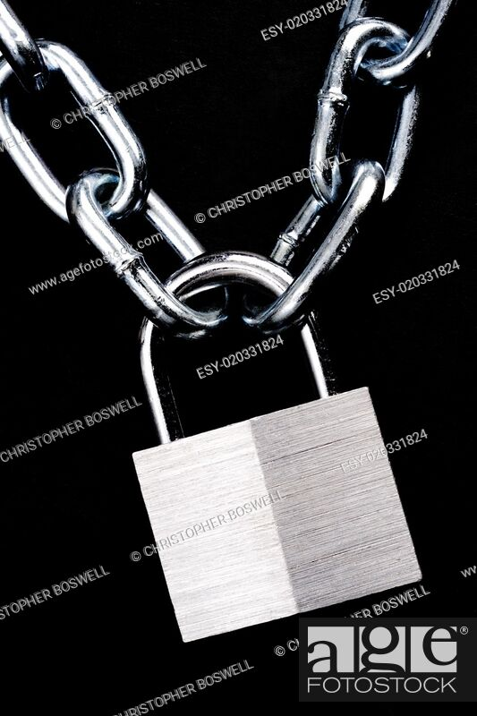 Photo de stock: Link Chain Connected By Keyed Steel Locking Padlock on Black.