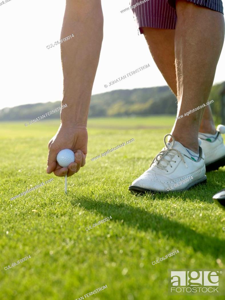 Stock Photo: Woman on golf tee.
