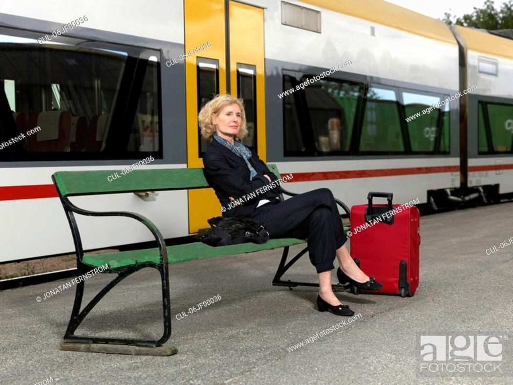 Stock Photo: Mature woman on train station.