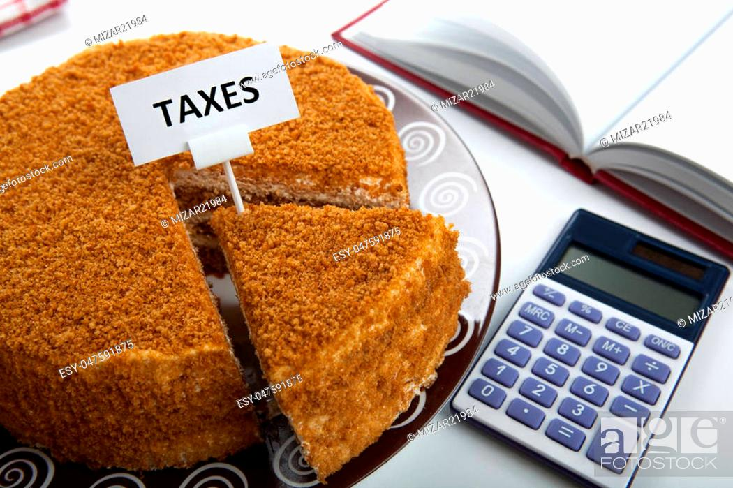 Stock Photo: office work and metaphor in the form of cake for the payment of taxes.