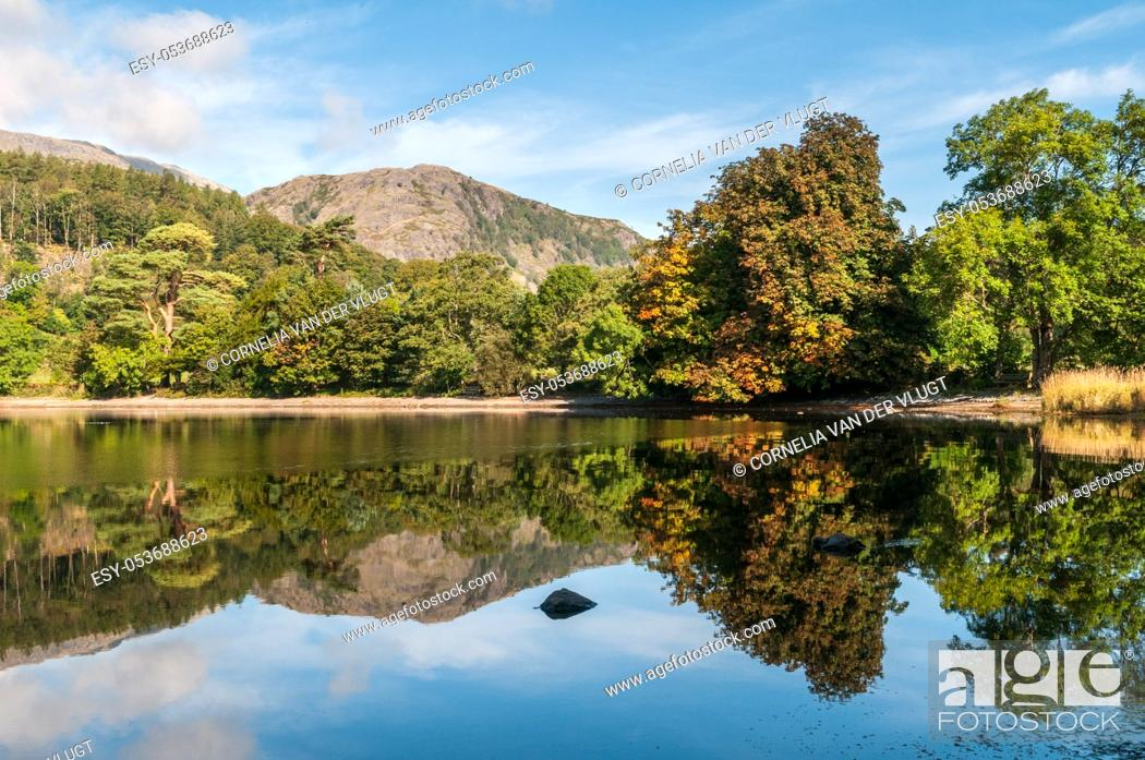 Stock Photo: An early autumn view of Coniston Water in the English Lake District. The first leaves of the trees are starting to turn brown.