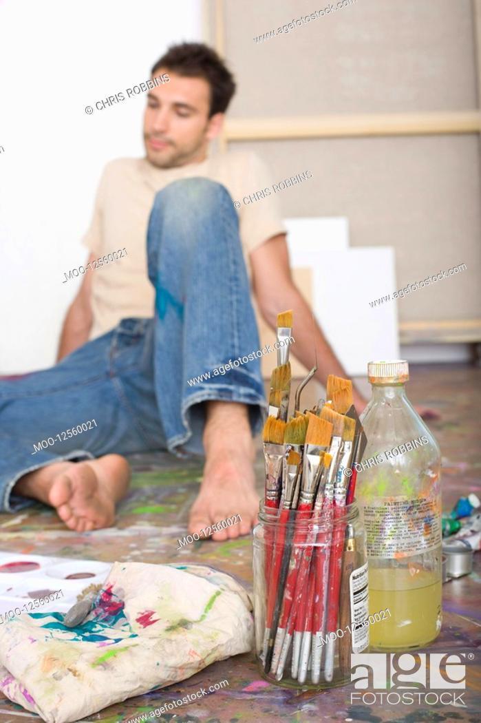 Stock Photo: Artist With Painting Tools on Floor of Studio.