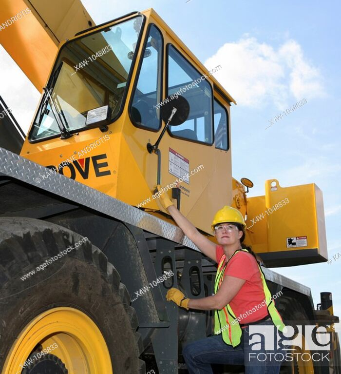 Stock Photo: Woman construction worker on a job site.