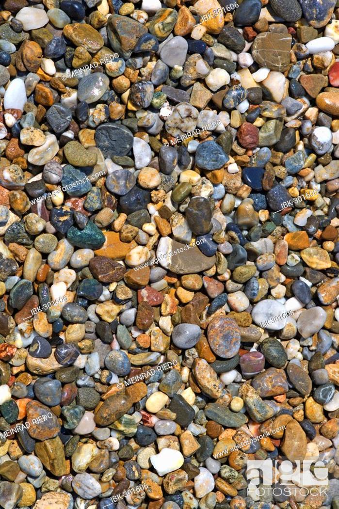 Stock Photo: Wet pebble stones.