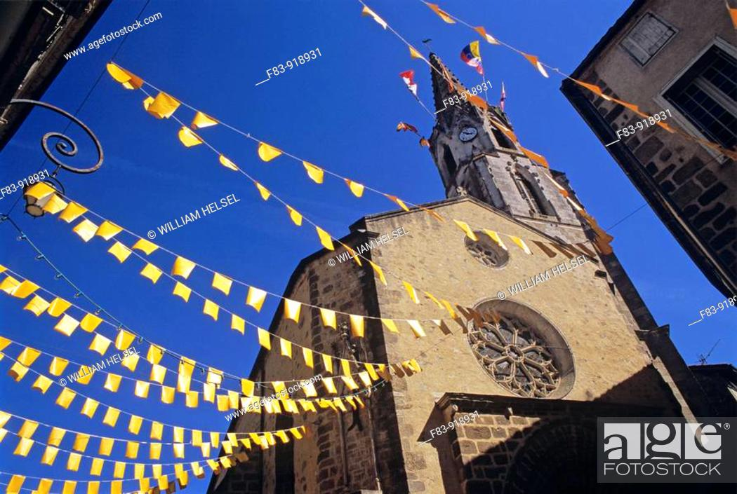Stock Photo: France, Poitou-Charente region, Vienne River valley, Confolen, old town, church tower with festive flags.