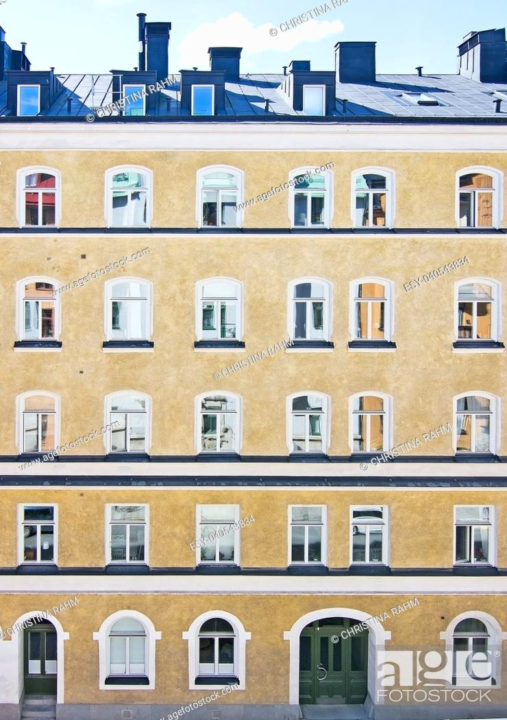 Stock Photo: Classic yellow roughcast Swedish residential building in Stockholm.