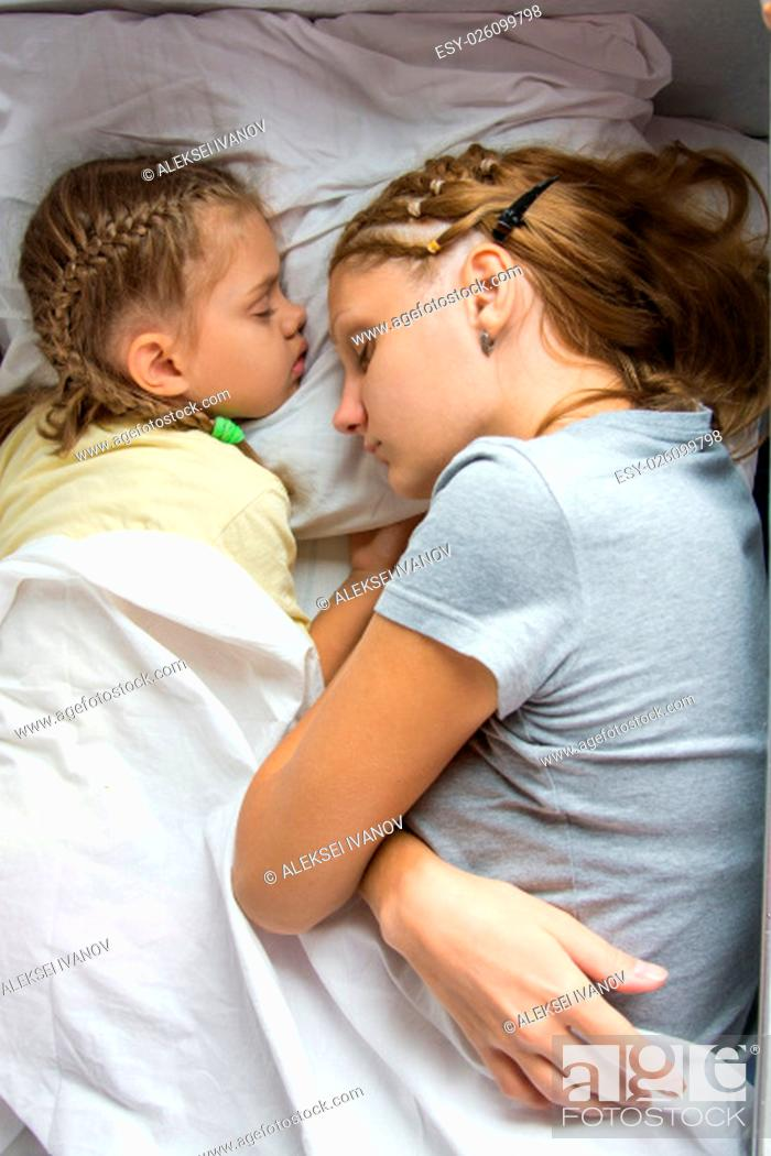 Stock Photo: My mother and six year old daughter sleep on the bottom shelf in a second-class train carriage.