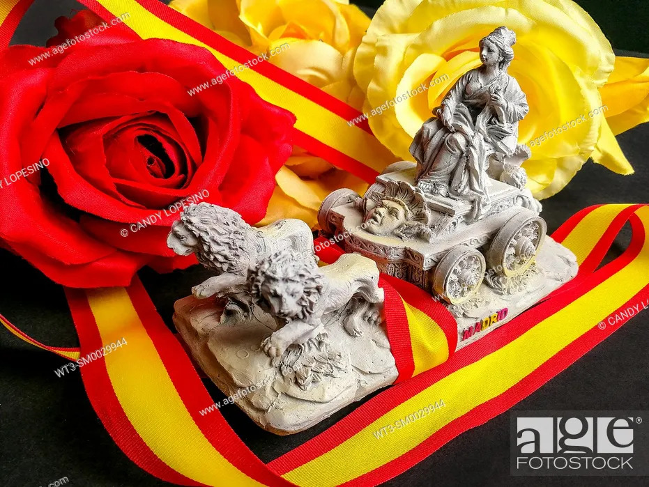 Stock Photo: Miniature of the Cibeles, souvenir of Madrid, ribbon of the flag of Spain and colored flowers on black background.