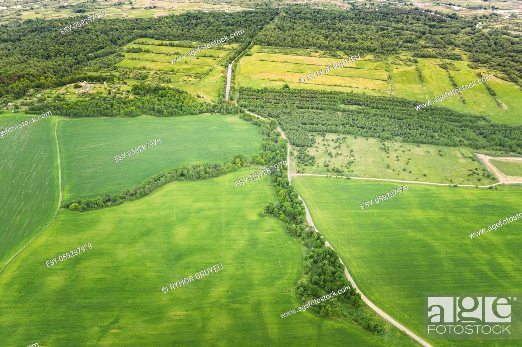 Stock Photo: Aerial View Spring Empty Field With Windbreaks Landscape. Top View Of Field And Forest Belt. Bird's Eye View. A Windbreak Or Shelterbelt Is A Planting Usually.