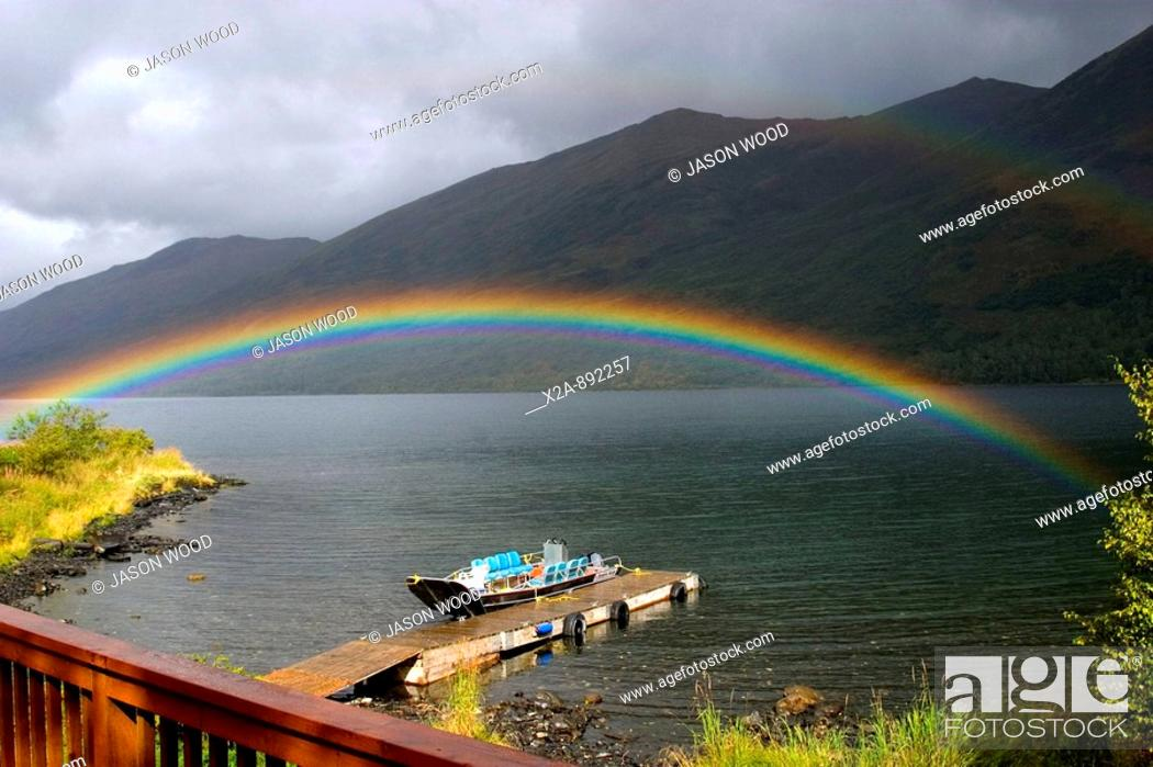 Stock Photo: KARLUK LAKE RAINBOW OVER BOAT.