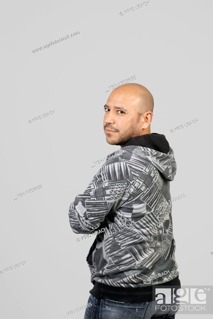 Stock Photo: Studio shot of Mexican man, looking at camera.