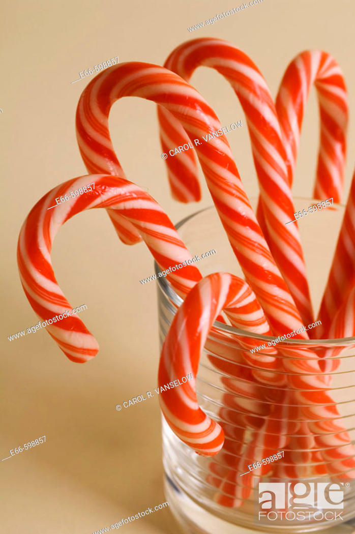 Stock Photo: Christmas candy canes in clear glass.