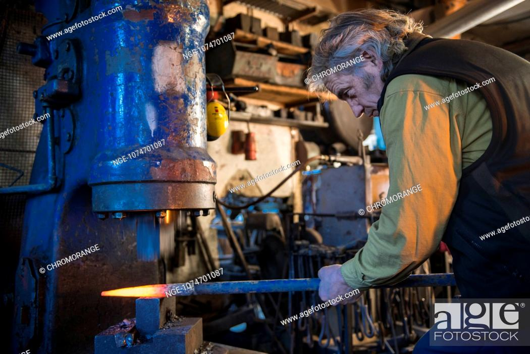 Blacksmith is working with an Electro Hammer, Stock Photo, Picture
