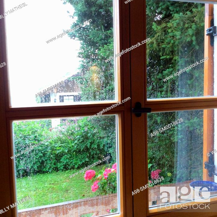 Stock Photo: Rainy day in Bavaria. Looking through the rainy window of a farmhouse in the countryside. Bavaria, Germany, Europe.