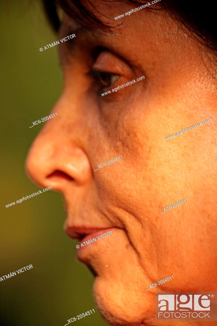 Stock Photo: closeup face portrait of a spanish adult woman.